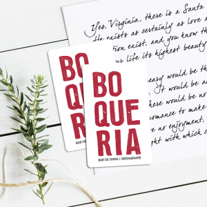 two Boqueria gift cards on top of a holiday letter